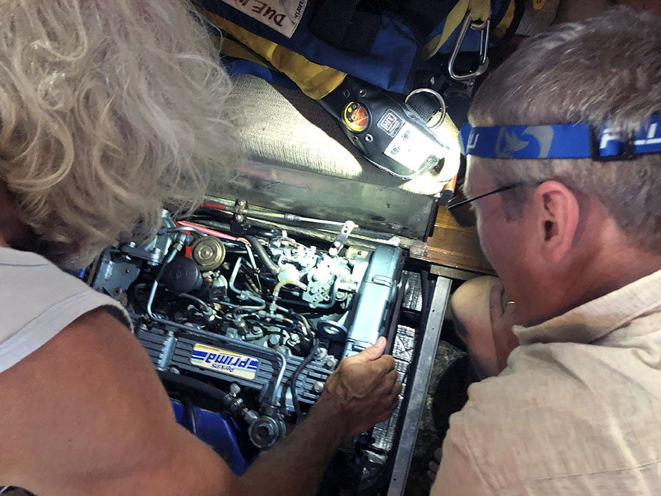 Kirk and Shane troubleshooting engine issues.