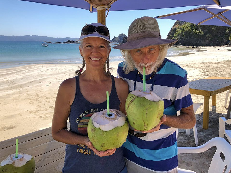 Heidi & Kirk with drinking coconuts, Tenicatita