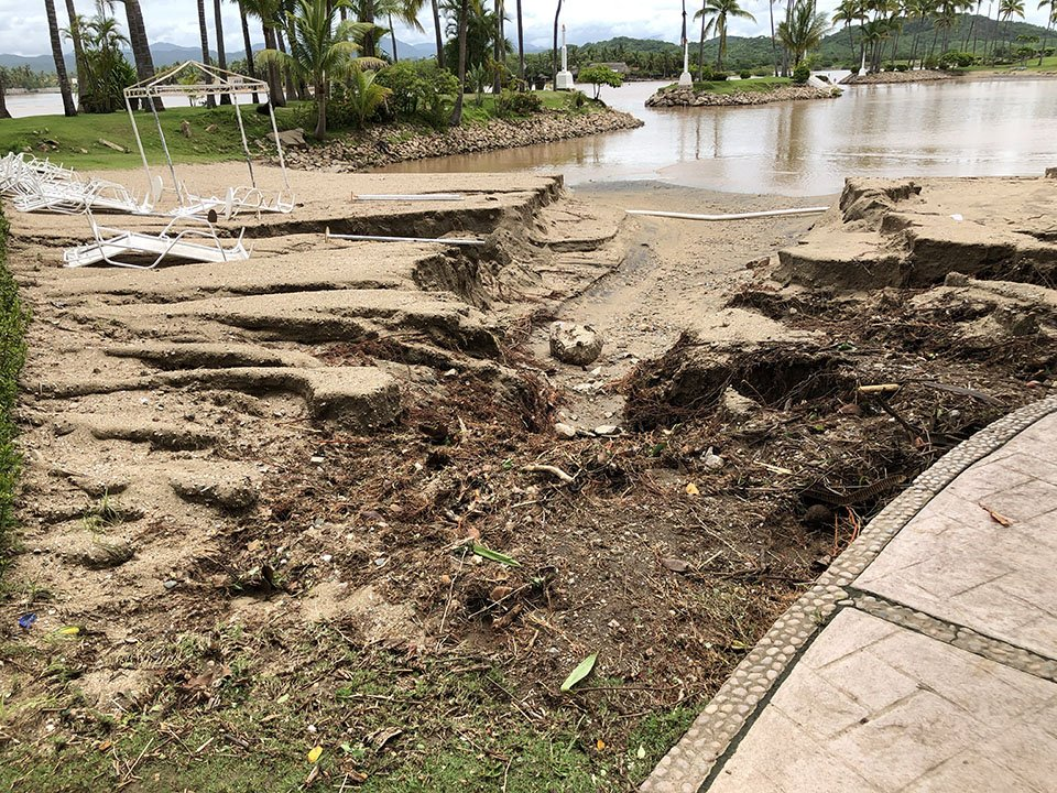 washed out beach at Isla de Navidad Resort & Marina